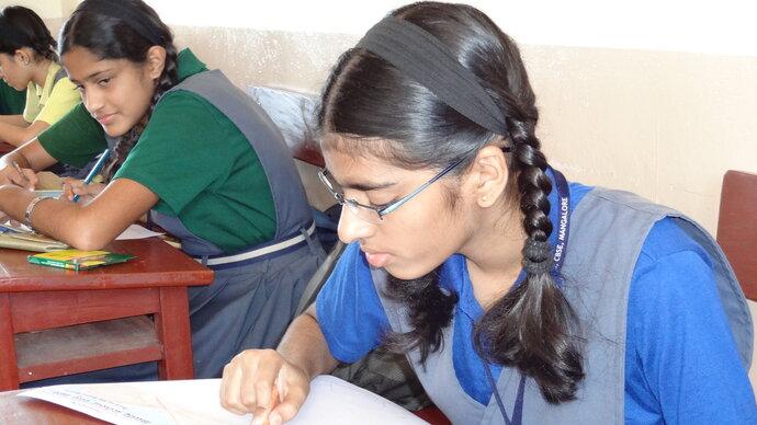 School girl writing at desk