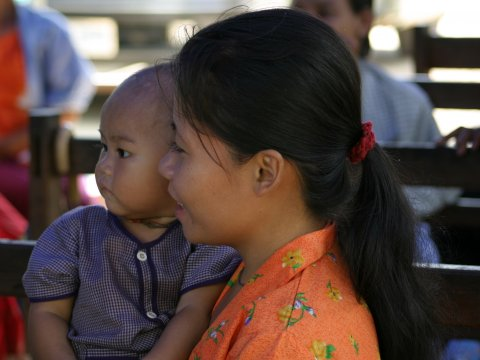 Mother holding young child in Thailand